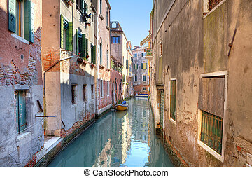 Small canal among houses. Venice, Italy.