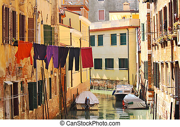 Small canal among old houses in Venice, Italy.