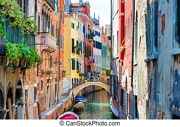 Small canal between houses in Venice