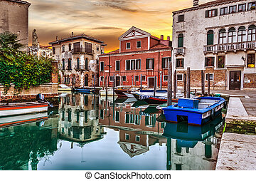 Small canal in Venice at sunset