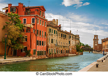 Small canal in Venice between old buildings
