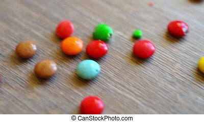 Small candies on wooden table