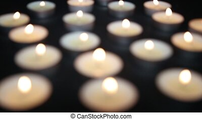 small candles burning on the table
