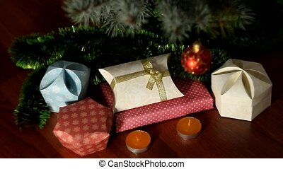 small candles near Christmas tree with gifts - small candles...