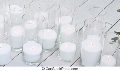 Small candles on wooden table