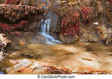 small cascade on mountain stream