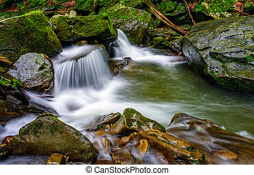 small cascade on the river among bouders