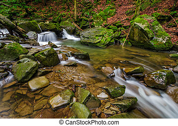small cascade on the river among boulders
