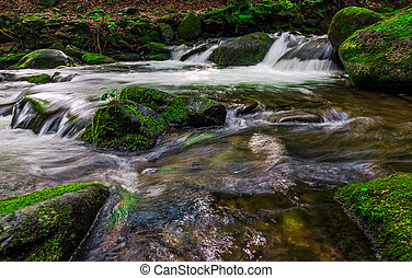 small cascade on the stream among bouders