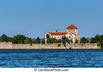 Small castle on the shores of a lake