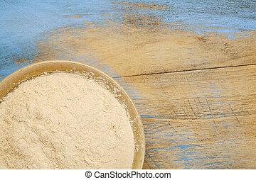 baobab fruit powder - small ceramic bowl of African baobab...