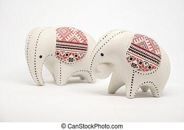 Small ceramic elephant isolated on white background.