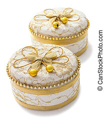 Small ceramic jewelry box isolated over a white background.