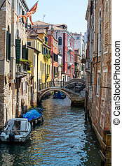 Small channel in the old town of Venice