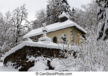 small chapel in the snow
