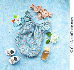Small child accessories on turquoise background