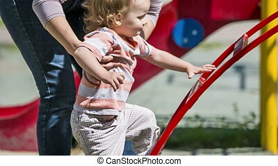 Small Child Climbing The Ladder In Playground