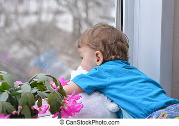 Small child looking out the window