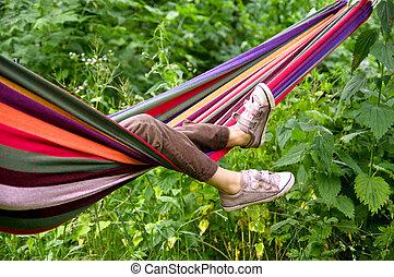 child lying in a hammock