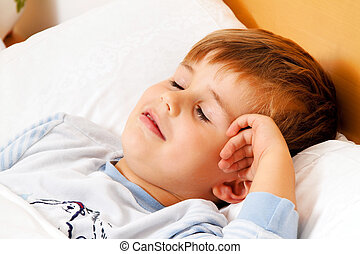 child lying in bed in the bedroom