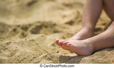 Small Child Playing In Sand