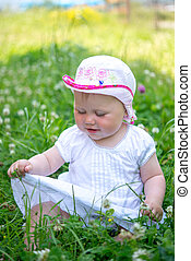 small child playing in the grass