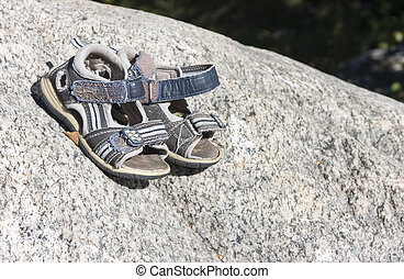 Small child shoes on rock
