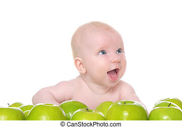 small child sitting in the green apples