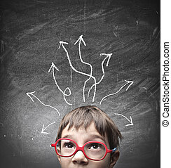 child thinks - small child thinks on blackboard background