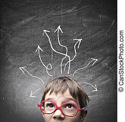 child thinks - small child thinks on blackboard background