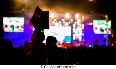 Small Child Watching Concert Sitting On Father's Shoulders