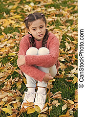 Small child with autumn leaves. Happy childhood. School time. Autumn leaves and nature. thoughtful little girl in autumn forest. Happy to be around. Real relaxation. Autumn beauty