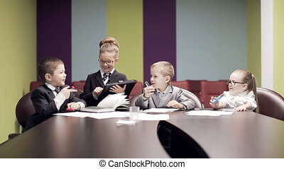 small children at meeting in office.static shot