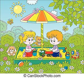 Small children playing in a sandbox on a sunny day