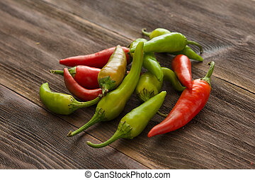Small chili peppers on a wooden table