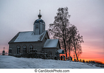 Small Christian church at sunset