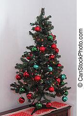 Small Christmas Tree on a Bureau in a Corner