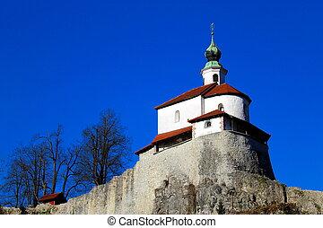 Small church on a rock outcrop