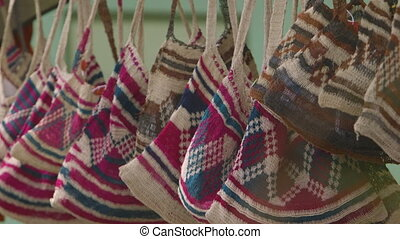 Small cloth/jute bags hanging - a closeup shot of small...