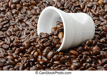 small coffe cup in coffee beans