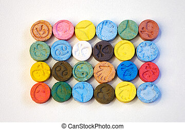 Small color pills of extasy (MDMA, E, X) collected by dealer...