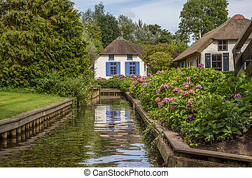 Small cottage at a canal in Giethoorn