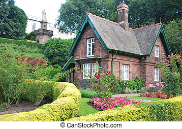 Small cottage surrounded by a beautiful garden