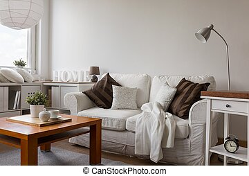 Small cozy living room in white flat