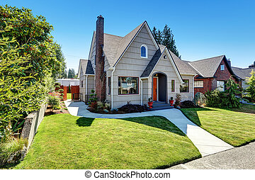 Small craftsman one-story exterior with wood siding.