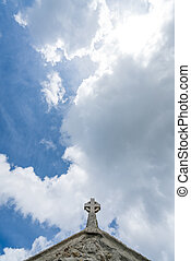 Small cross on top of a church
