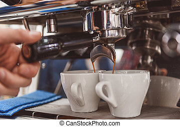 Small cups filling with drink - Coffee is pouring from...