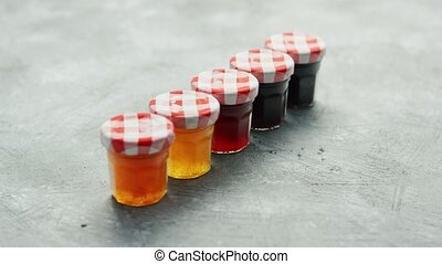 Small cups with different marmalade