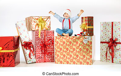 Small cute boy on plenty of presents