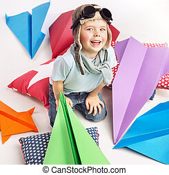 Small cute boy with plenty toy planes